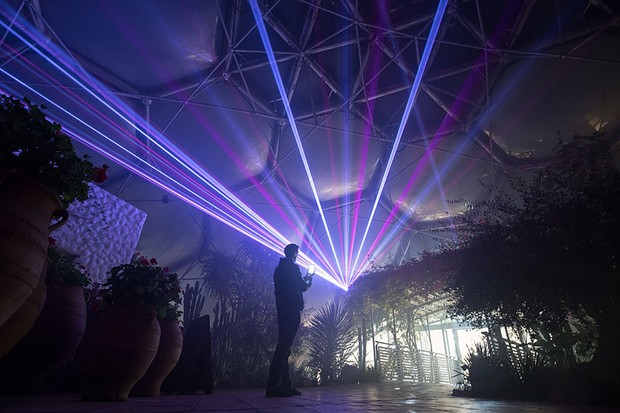 ST AUSTELL, ENGLAND - NOVEMBER 23:  The Eden Festival of Light and Sound lasers illuminate the interior of the Mediterranean Biome at The Eden Project on November 23, 2016 in St Austell, England.  A new laser light and sound show curated by acclaimed light artist Chris Levine aims to bring all the colours of Christmas to Eden and will run from on selected nights from tomorrow to December 30 at the home of the world-famous Biomes in Cornwall. Visitors standing on the viewing platform will be able to watch lasers pierce through the darkness to create a canopy of light, painting the Biomes and the plant displays with festive colours whilst inside the Mediterranean Biome there will be the stage for a choreographed performance of after dark music and light.  (Photo by Matt Cardy/Getty Images)