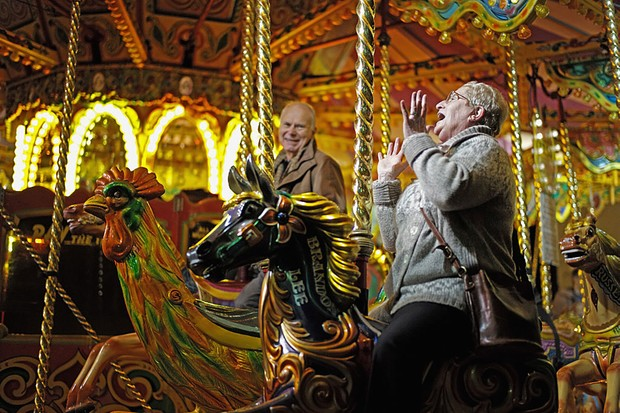 WORCESTER, ENGLAND - NOVEMBER 26:  Visitors and shoppers enjoy the carousel during the Worcester Victorian Christmas Fayre on November 26, 2015 in Worcester, England. Now in its 23rd year the Worcester Victorian Christmas Fayre starts off the festive season with market stalls, festive foods and entertainment. The celebrations are started each year by the The Right Worshipful the Mayor of Worcester, Councillor Roger Knight and choristers from The Worcester Cathedral Voluntary Choir. The fayre takes place between 26th-29th November 2015.  (Photo by Christopher Furlong/Getty Images)
