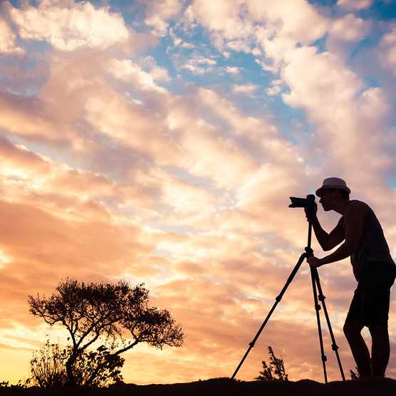 Male photographer taking photos in a beautiful nature setting