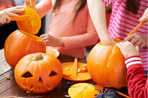 Children making Halloween Jack O'lanterns