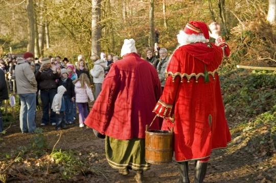 Father and Mrs Christmas welcoming visitors to an event at Chirk Castle, Wrexham, Wales.