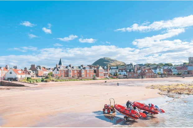 The igneous rock of Berwick Law looms over the West Bay and the seaside town of North Berwick