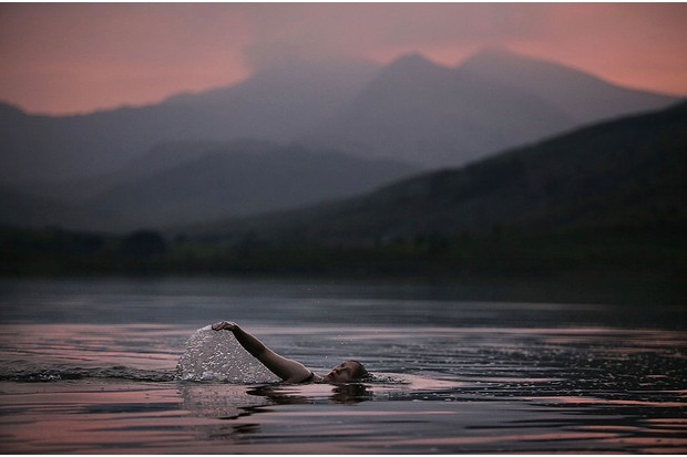 Lady Alice Douglas swims in Llyn Mymbyr in the shadow of the Snowdon Horseshoe in North Wales on June 30, 2009 in Capel Curig, United Kingdom. Lady Alice has been wild swimming in lakes and rivers since she was a child and often takes a plunge with her children in the wild waters around her home in the Snowdonia foothills. Swimming in wild rivers and lakes is gaining in popularity across Britain with maps and books detailing the locations of the wildest outdoor swims.
