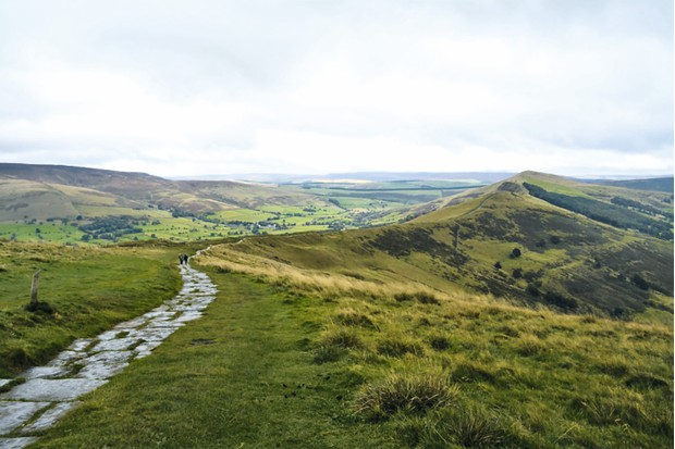 The easy stone footpath to the top of Mam Tor, sometimes known as Mother Hill, rewards walkers with panoramic views of the Peaks