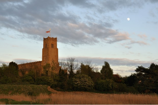 Holy Trinity Church or otherwise known as the Cathedral of the Marshes in Blythburg, Suffolk captured with a moonrise./Getty Images