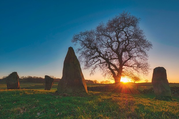 Spectacular sunset on a bitterly cold day at The Grey Ladies / Nine Stone Close Stone Circle, Robin Hood's Stride Peak District National Park