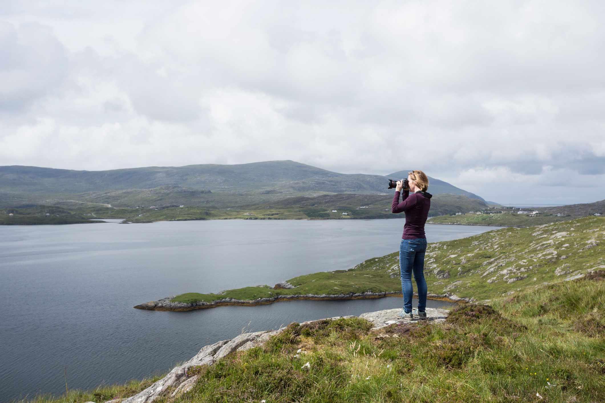 Woman taking a photo Scotland