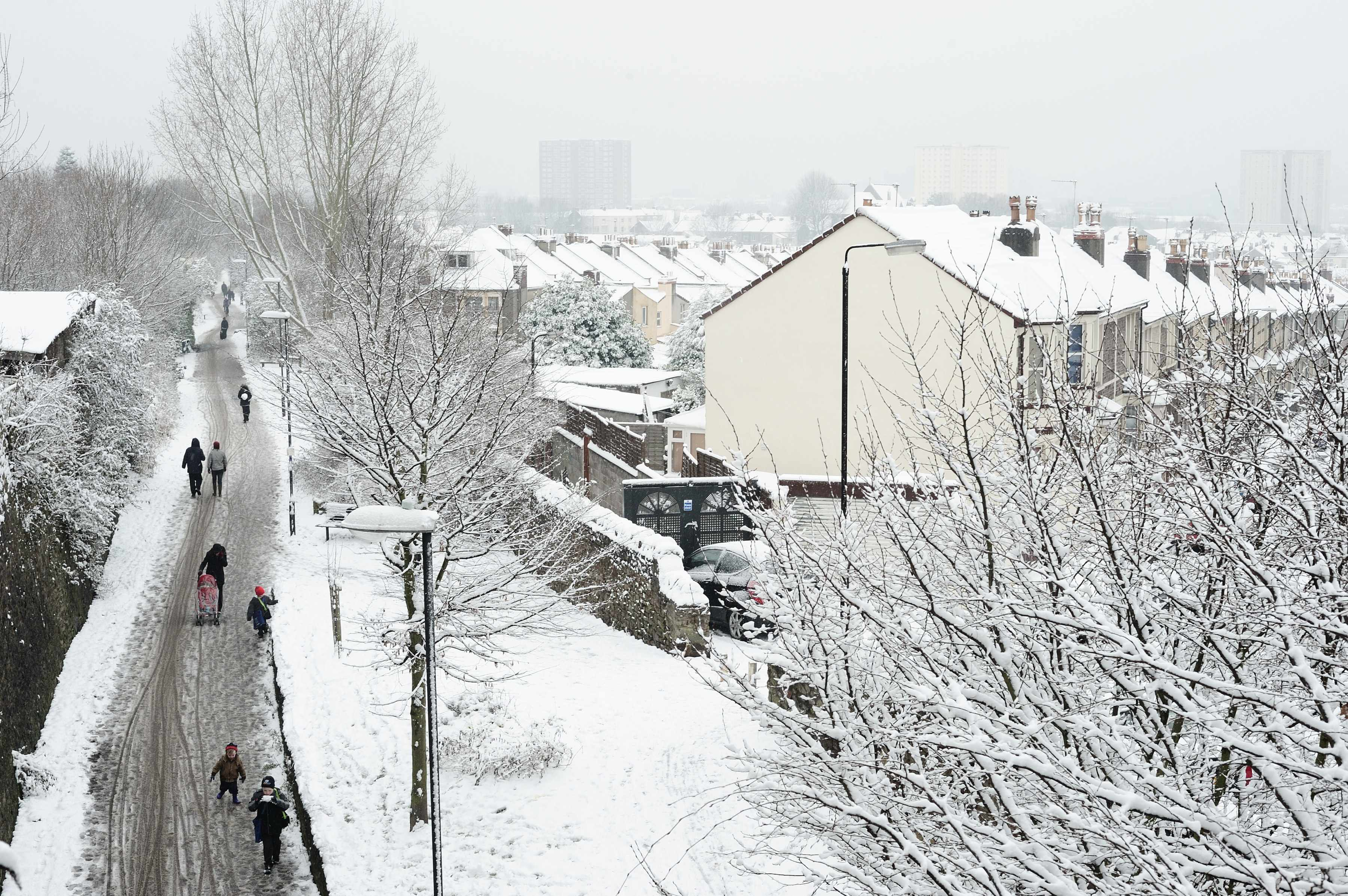 Traffic free path in the snow. Bristol and Bath Railway Path, National Route 4 at Easton (Devon Road Bridge looking west into city)