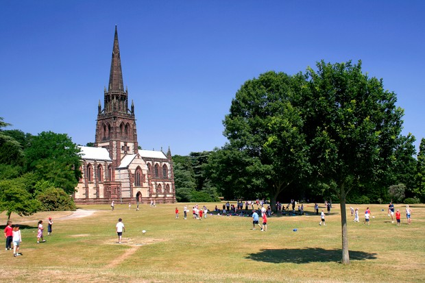 Visitors outside the Anglican Church of St. Mary the Virgin at Clumber Park, a country park in the Dukeries near Worksop in Nottinghamshire. (Visitors outside the Anglican Church of St. Mary the Virgin at Clumber Park, a country park in the Dukeries n