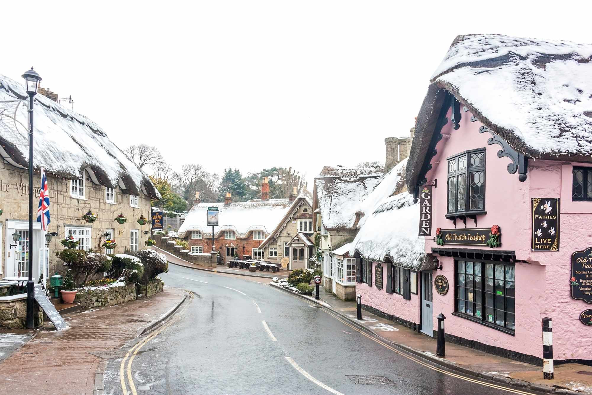 Snow topped thatched cottages