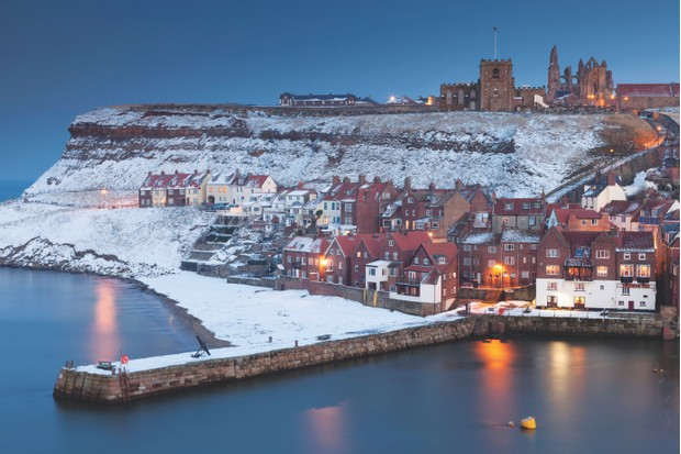 Winter dawn breaking over the river Eske in Whitby on the Yorkshire coast