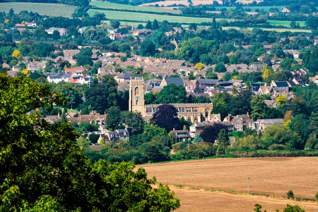 The Cotswold town of Winchcombe viewed from Cleeve Common near Cheltenham, Gloucestershire