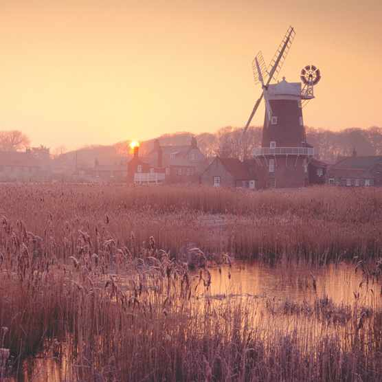 Cley next the Sea windmill and surrounding marshes in Norfolk ©Alamy