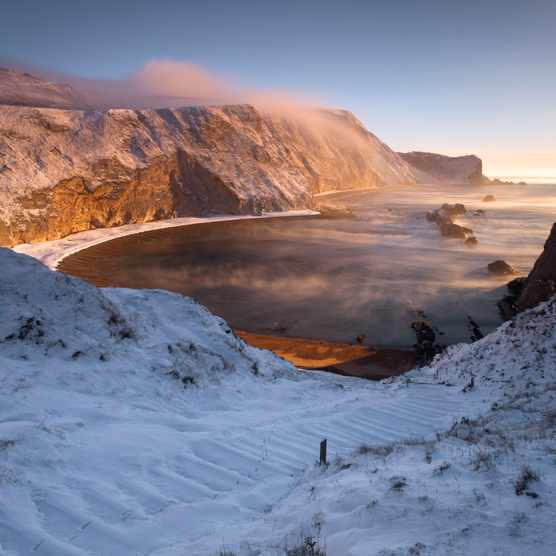 """A very cold winter morning begins at St Oswalds bay on the world heritage coastline of Dorset/Credit: Getty Images"