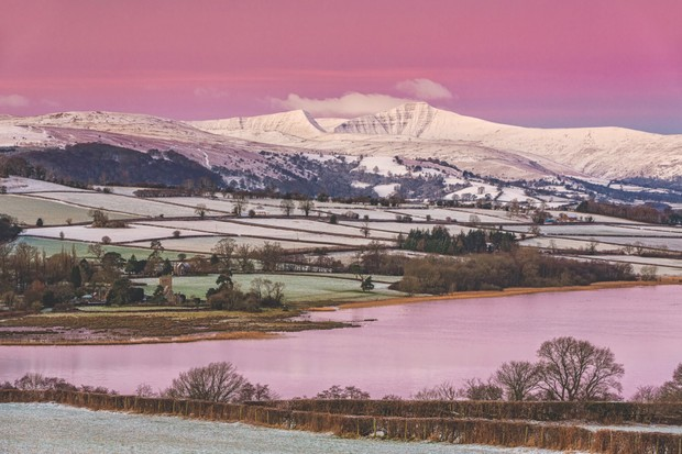View of snow covered farmland and hills at sunrise, looking from Mynydd Llangorse, Llangorse Lake ©Alamy