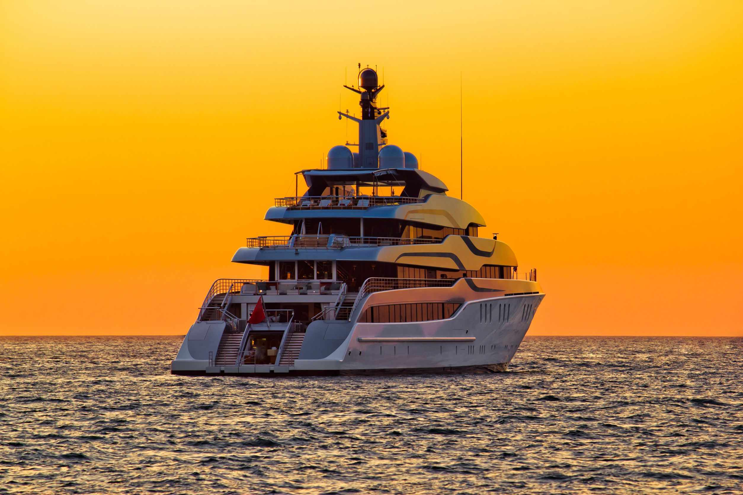 15488764 - luxury yacht on open sea at golden sunset