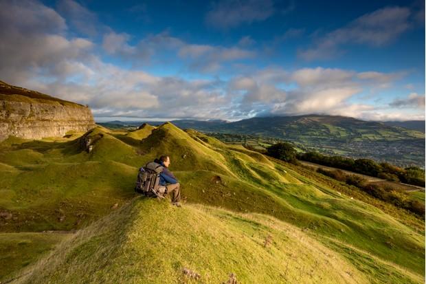Hiker sitting enjoying the view on a hillside