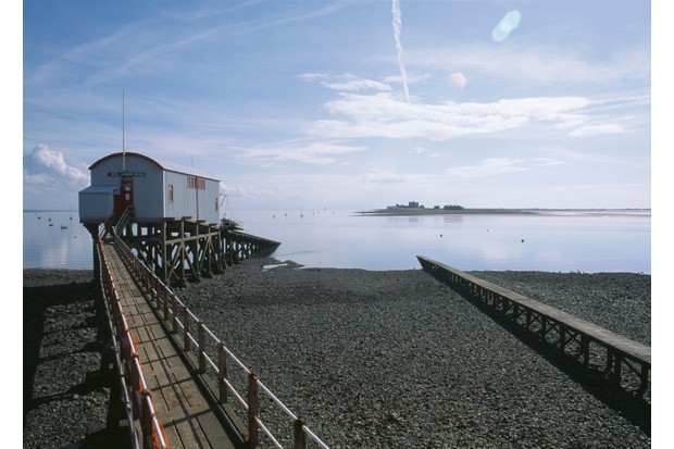 The lifeboat station in the harbour on Roa Island, Barrow-in-Furness, Cumbria circa 1989. The castle on nearby Piel Island can be seen in the background. (Photo by RDImages/Epics/Getty Images)