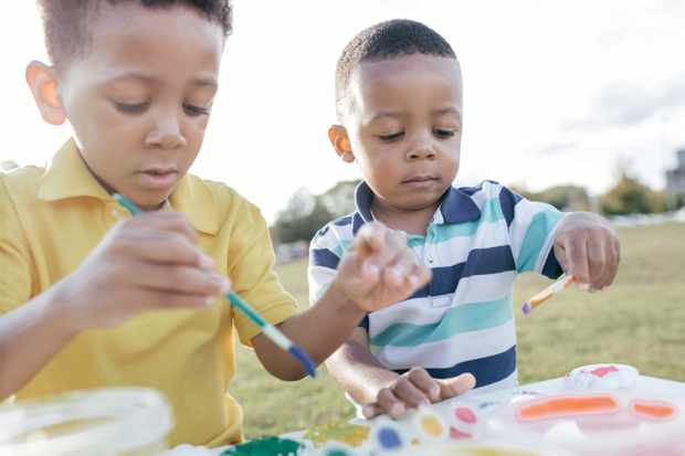 Children painting outdoors
