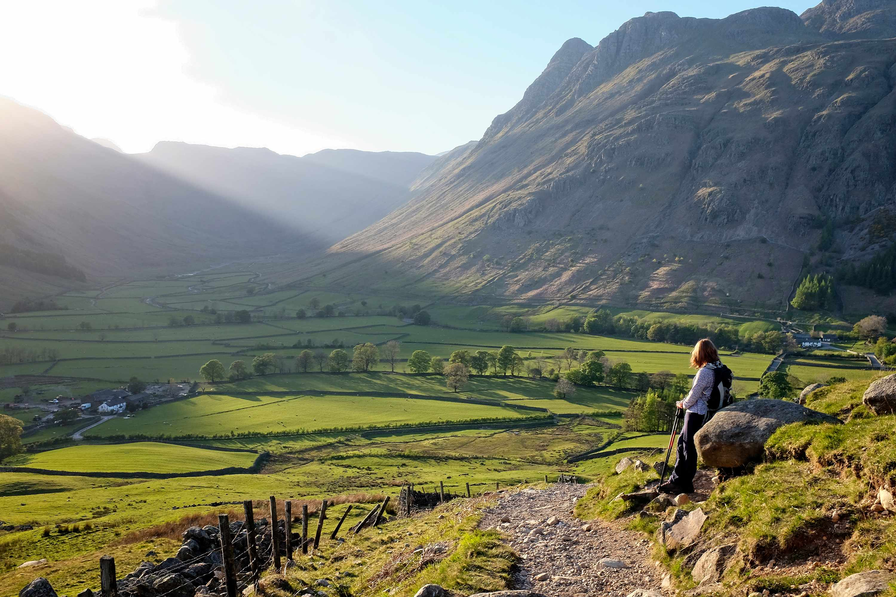 Sunlit valley and hillwalker; English Lake District, U.K