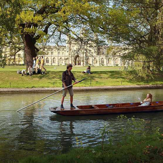 CAMBRIDGE, UNITED KINGDOM - APRIL 19:  Members of the public punt along the river Cam in front of the colleges of Cambridge University on April 19, 2011 in Cambridge, England. The UK is currently basking in fine weather with the Met Office predicting temperatures up to 25C this week. The fine weather comes as many people are taking advantage of the combination of a late Easter and additional Bank Holiday for the Royal Wedding to take extended breaks and holidays.  (Photo by Oli Scarff/Getty Images)