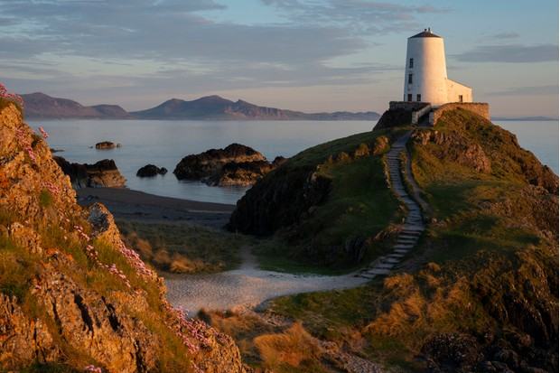 Llanddwyn Island Lighthouse in Snowdonia National Park at sunset, North Wales.