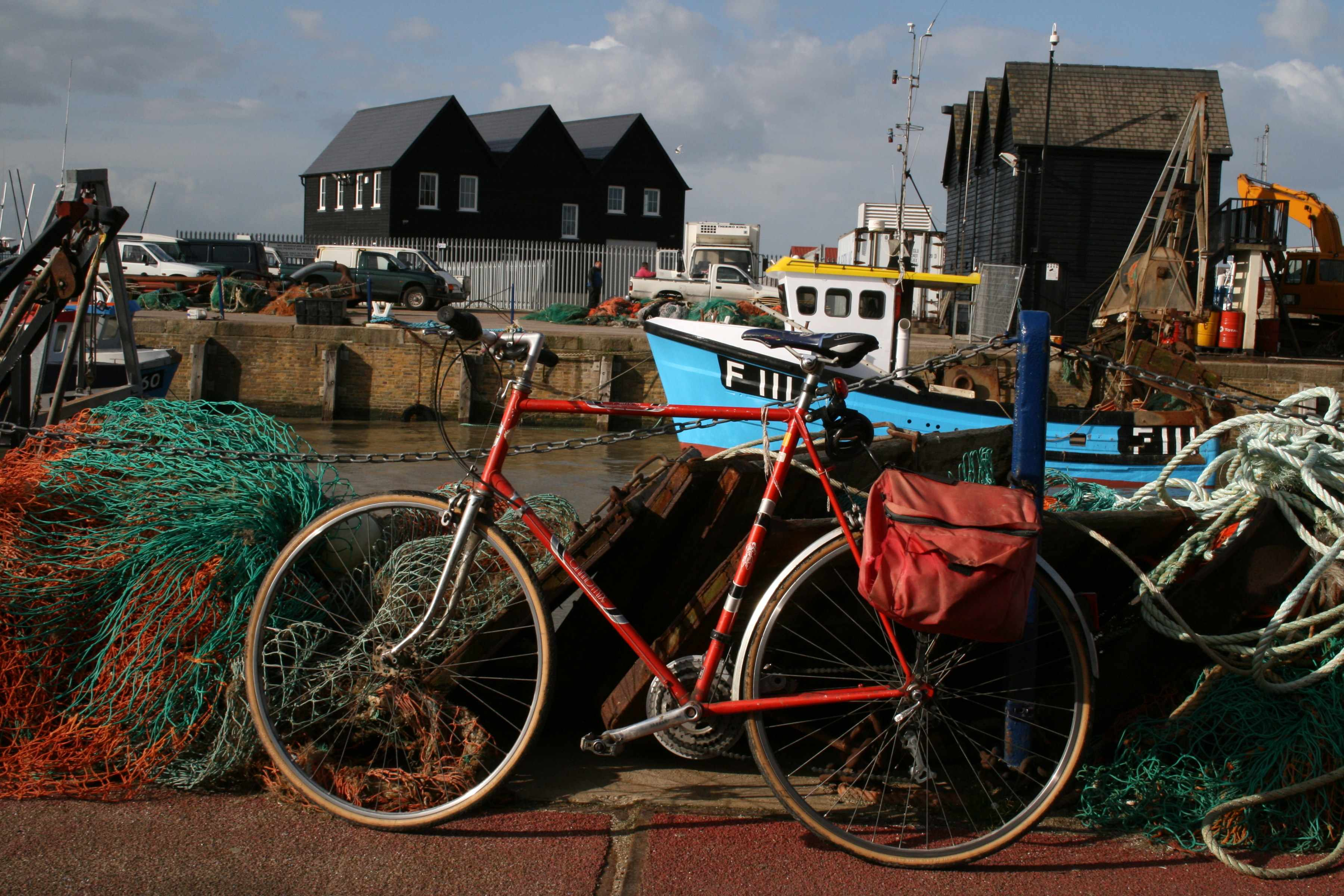 """""""National Route 1. The Fish Quay and Harbour at Whitstable Kent, traditional buildings and fishing nets."""""""