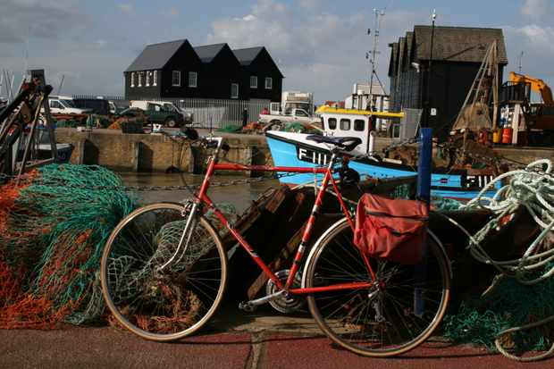 """National Route 1. The Fish Quay and Harbour at Whitstable Kent, traditional buildings and fishing nets."""