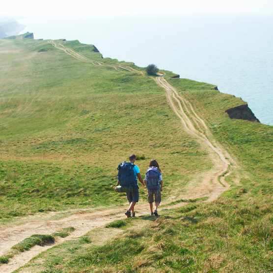Couple walking on cliff path