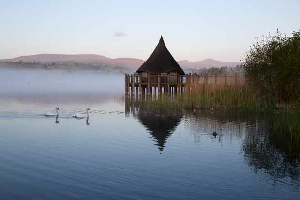 Llangorse Lake and Crannog Island in morning mist, Llangorse, Brecon Beacons National Park, Powys, Wales, United Kingdom, Europe