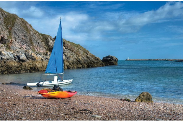 Sailing boat grounded in Churston Cove