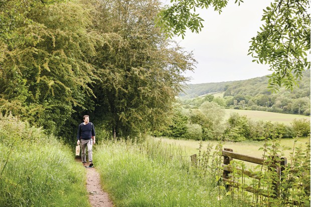 Fergus Collins walks down a country path in Abergavenny