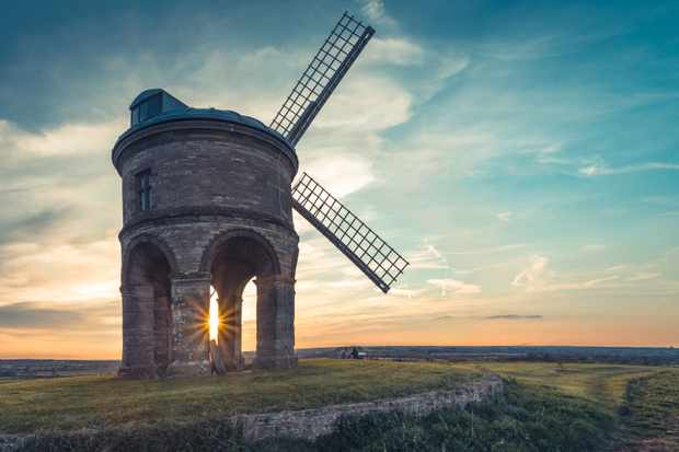 Chesterton Windmill, a 17th century cylindric stone tower windmill with an arched base, located outside the village of Chesterton, Warwickshire, at sunset (Photo by: Davoud Davies via Getty Images)