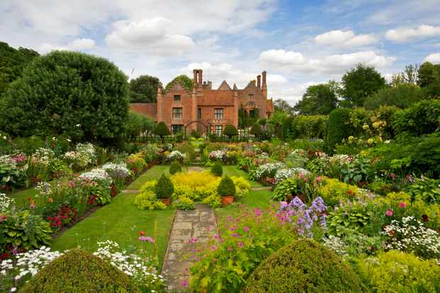 The beautiful award winning gardens of Chenies Manor in Buckinghamshire with a wide variety of flowering plants and shrubs.