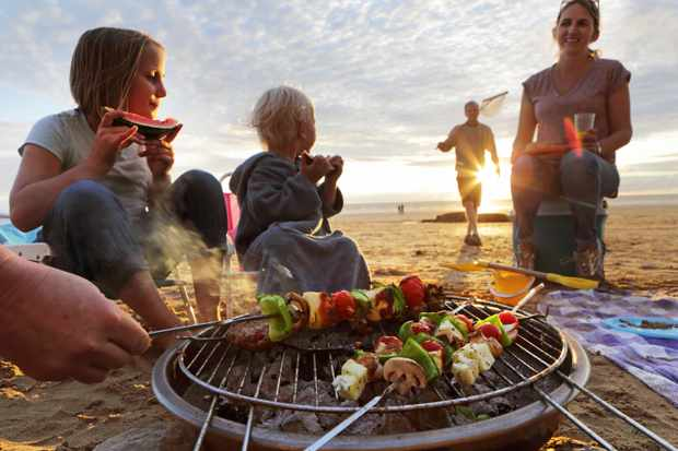 Family having a beach BBQ