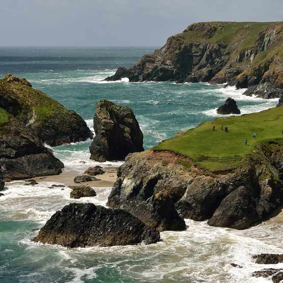 Visitors walking along the coastal path of Kynance Cove, The Lizard Peninsula (Photo by: John Millar for The National Trust)