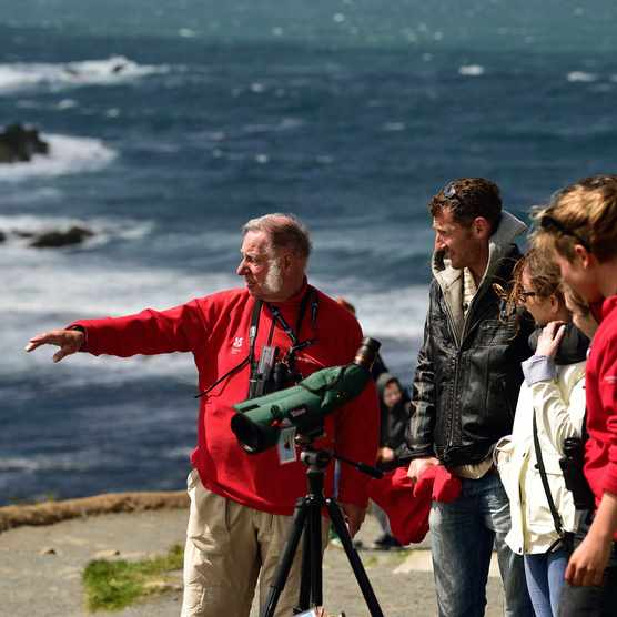 Volunteer rangers show visitors local wildlife from the watchpoint in the Lizard Peninsula (Photo by: John Millar for The National Trust)