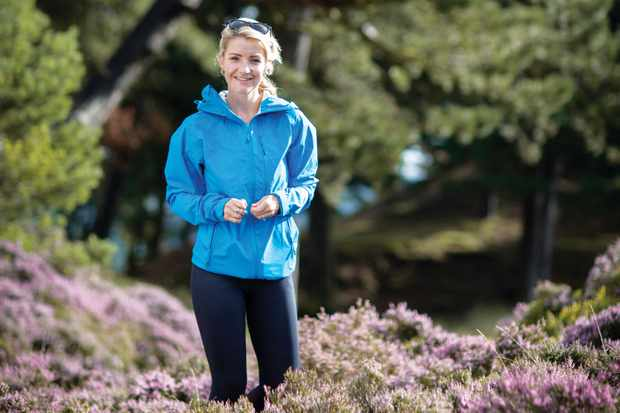 Woman waling in heather