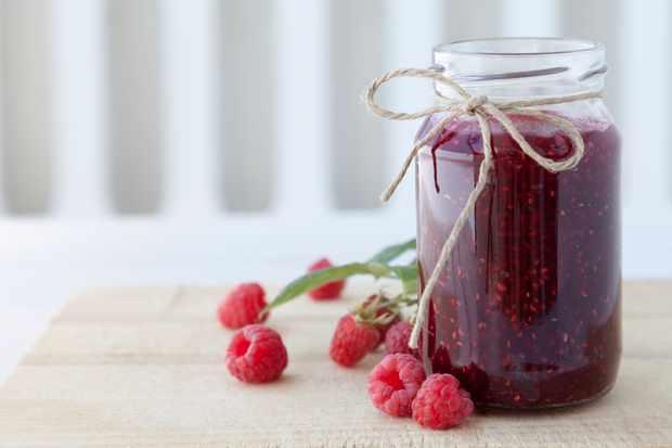 Raspberry jam on table