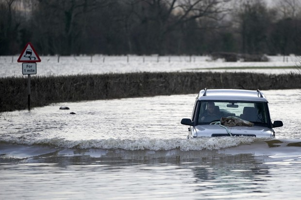 HEREFORD, ENGLAND - FEBRUARY 17: A Land Rover wades through flooded roads in the  Wye Valley, near the hamlet of Wellesley, following Storm Dennis on February 17, 2020 in Hereford, England. Storm Dennis is the second named storm to bring extreme weather in a week and follows in the aftermath of Storm Ciara. (Photo by Christopher Furlong/Getty Images)