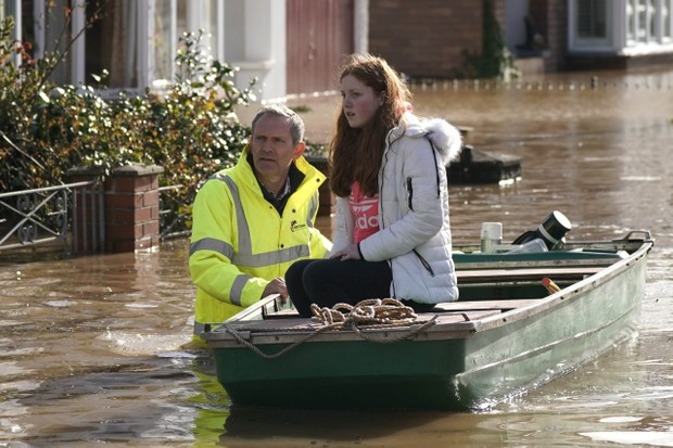 HEREFORD, ENGLAND - FEBRUARY 17: A rescue worker helps a resident to safety on a boat following Storm Dennis on February 17, 2020 in Hereford, England. Storm Dennis is the second named storm to bring extreme weather in a week and follows in the aftermath of Storm Ciara. (Photo by Christopher Furlong/Getty Images)