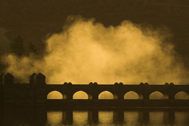 Clouds of mist rising over bridge at dawn, Lake Vyrnwy RSPB reserve