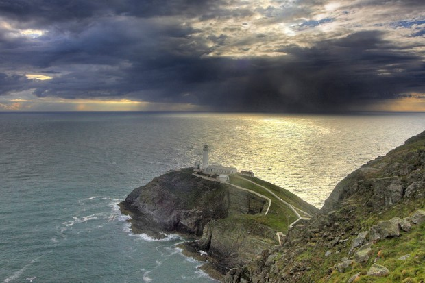 View showing lighthouse with approaching storm, South Stack RSPB reserve, Wales