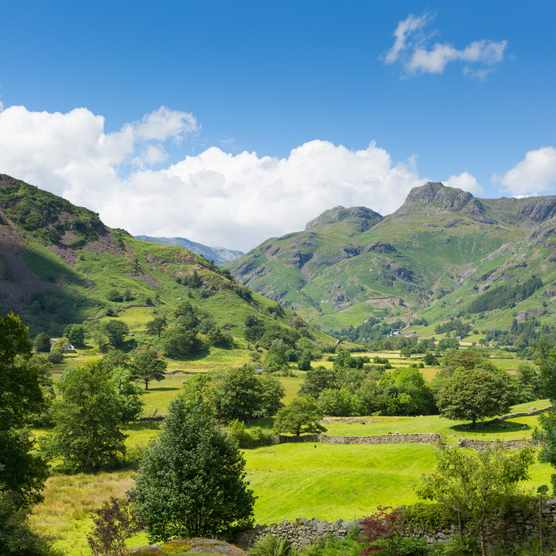 Langdale, Lake District, Cumbria with mountains fells and blue sky and clouds in summer