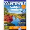 Countryfile October 2021 magazine cover with red leafy trees around a pretty lake
