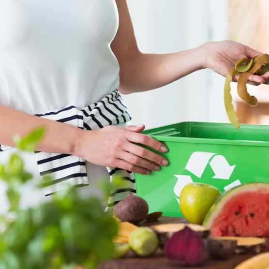 Recycling organic kitchen waste. © Katarzyna Bialasiewicz/Getty