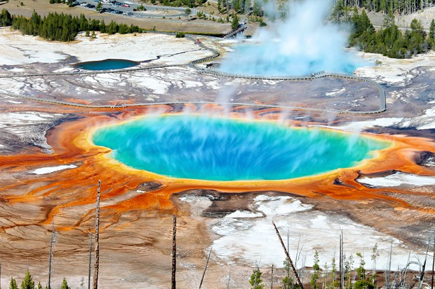 Geothermal pool with steam rising in Yellowstone National Park