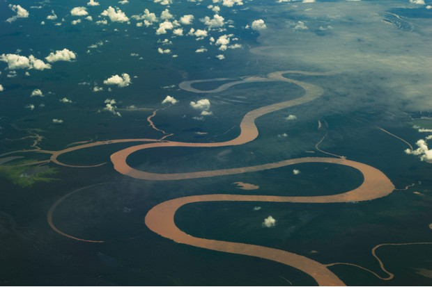 Aerial view of the Amazon river twisting through the rainforest near Manaus