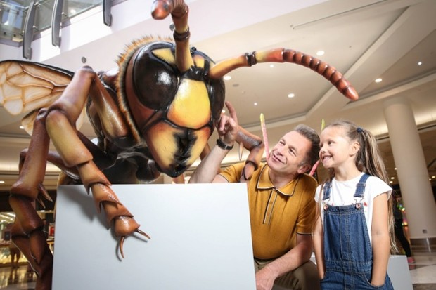 Chris Parkham and a child with the model of a hornet. © Big Bugs on Tour