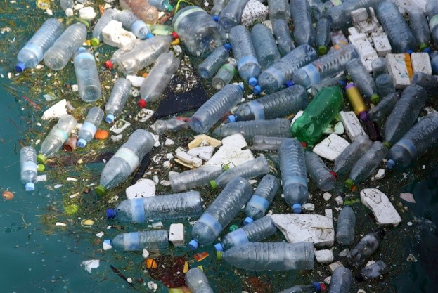 Marine pollution, mainly made up of plastic bottles and polystyrene floating in Hinnavaru Harbour, Maldives, Indian Ocean.